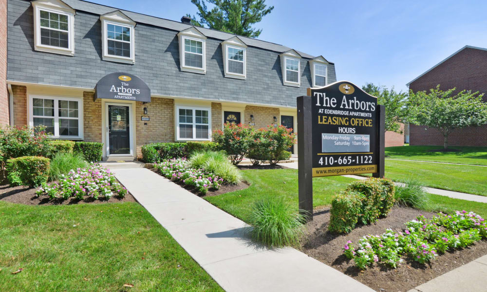 Community signage outside of the leasing office at Arbors at Edenbridge Apartments & Townhomes in Parkville, MD
