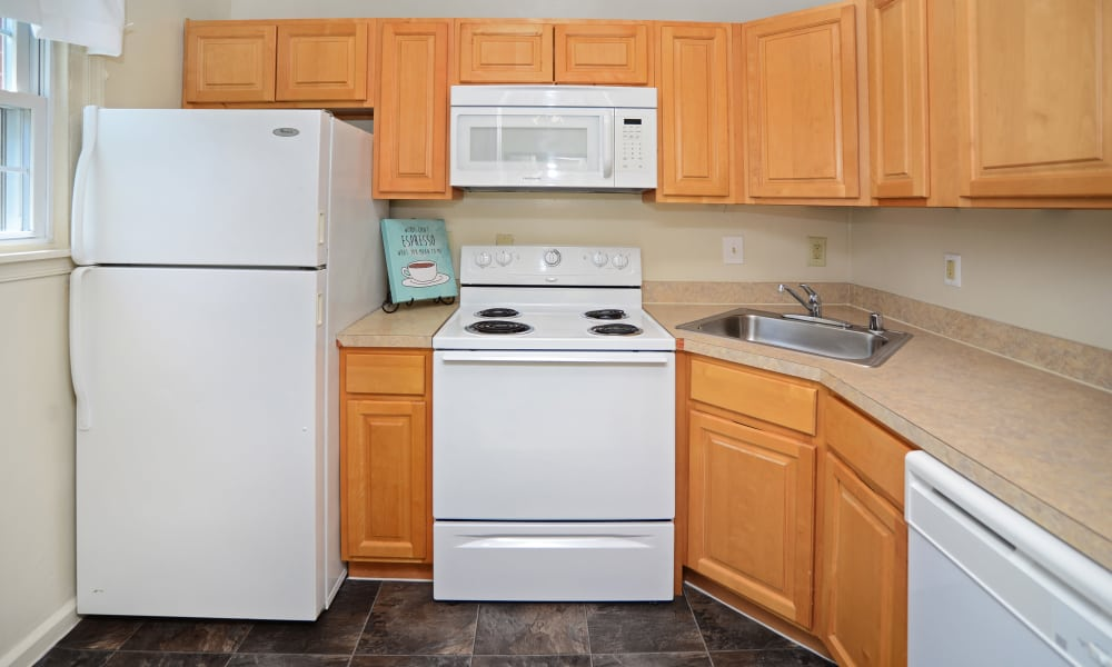 Oak Grove Apartments & Townhomes offers a fully equipped kitchen in Middle River, MD