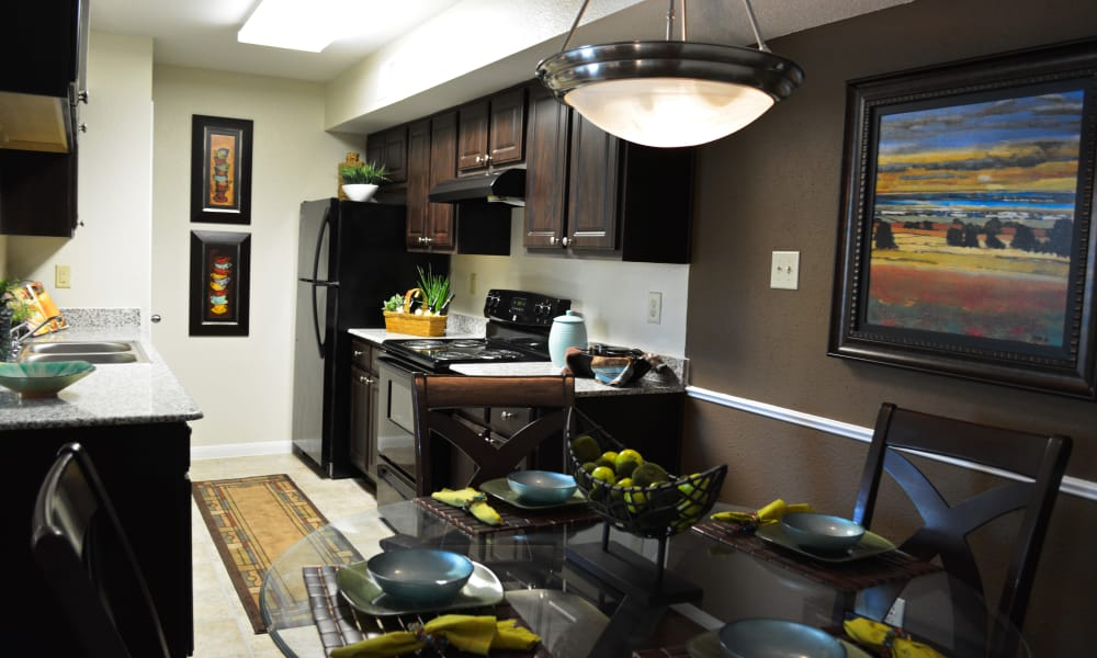 Dining room and kitchen at The Abbey At Enclave apartments in Houston, TX