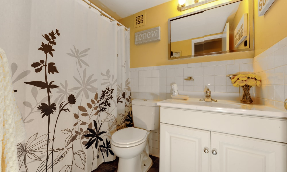 Model bathroom with wonderful yellow touches at The Reserve at Greenspring in Baltimore, MD