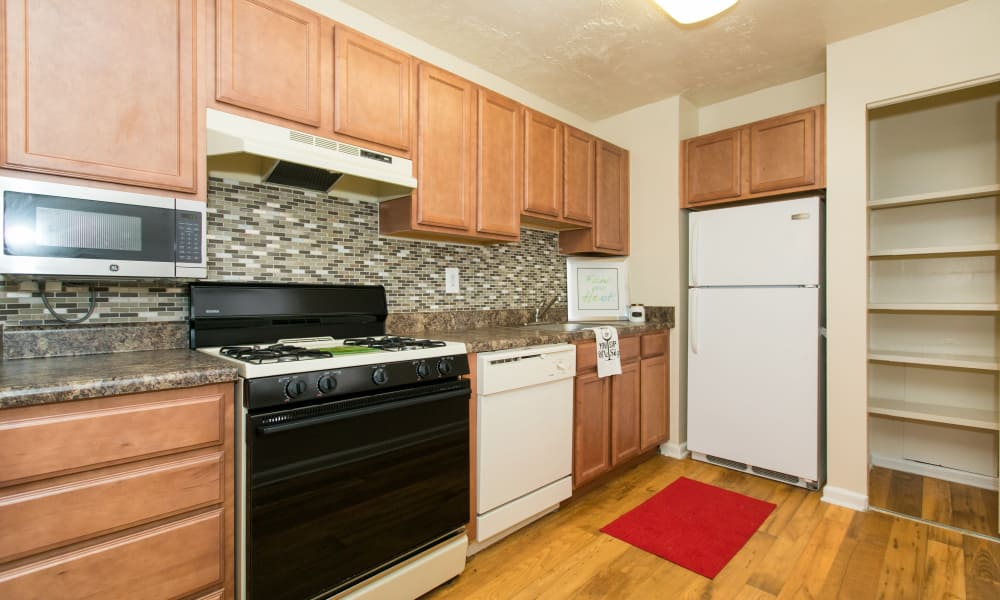 Enjoy apartments with a kitchen at Quail Hollow Apartment Homes