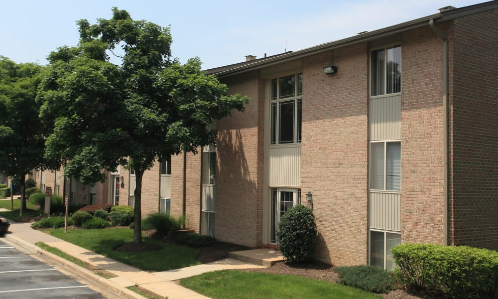 Walking paths outside apartments at Quail Hollow Apartment Homes in Glen Burnie, Maryland