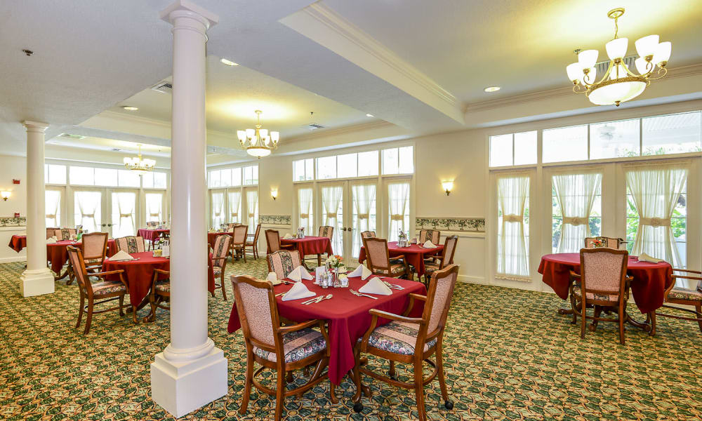 Large open dining hall at Arbor Oaks at Greenacres in Greenacres, Florida