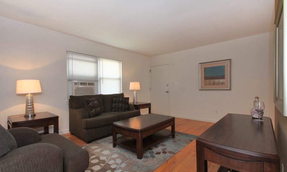 Elmwood Village Apartments & Townhomes offers a beautiful living room in Elmwood Park, New Jersey