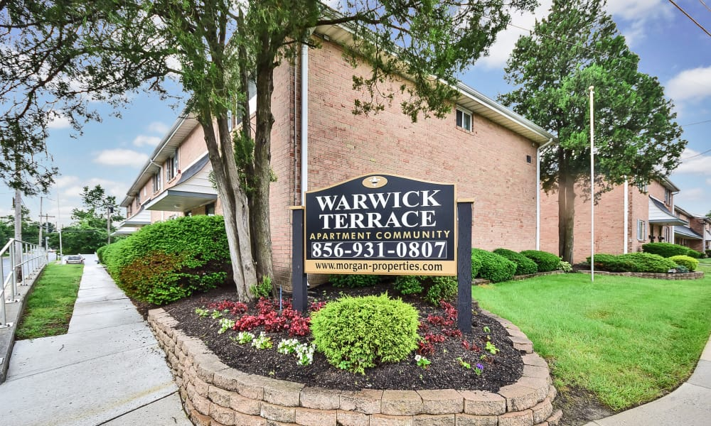 Welcome sign at Warwick Terrace Apartment Homes in Somerdale, New Jersey