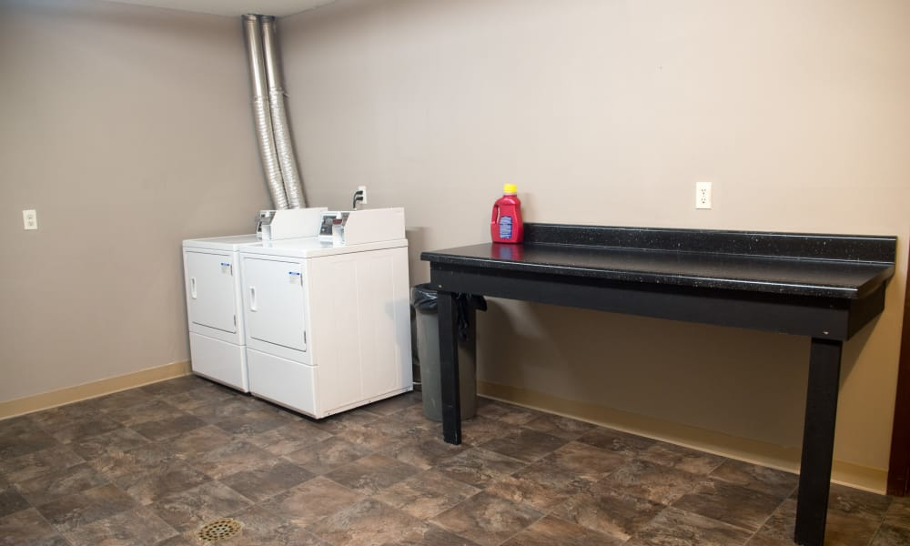 Washer and dryer machine at Squires Manor Apartment Homes in South Park, PA