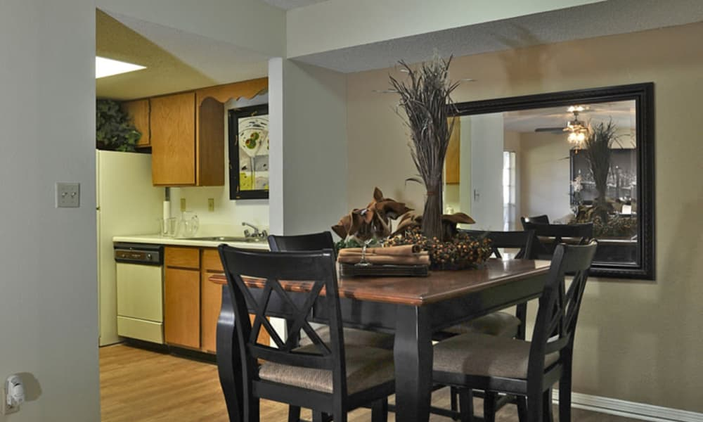 Enjoy apartments with a modern dinning table at Wind Tree