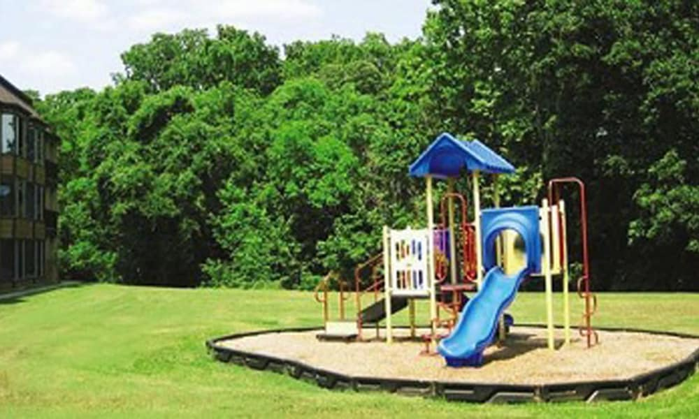 A playground that is great for entertaining at Residence at River Bend in Shreveport, Louisiana