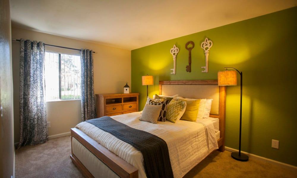 Cozy bedroom at apartments in Rialto, California