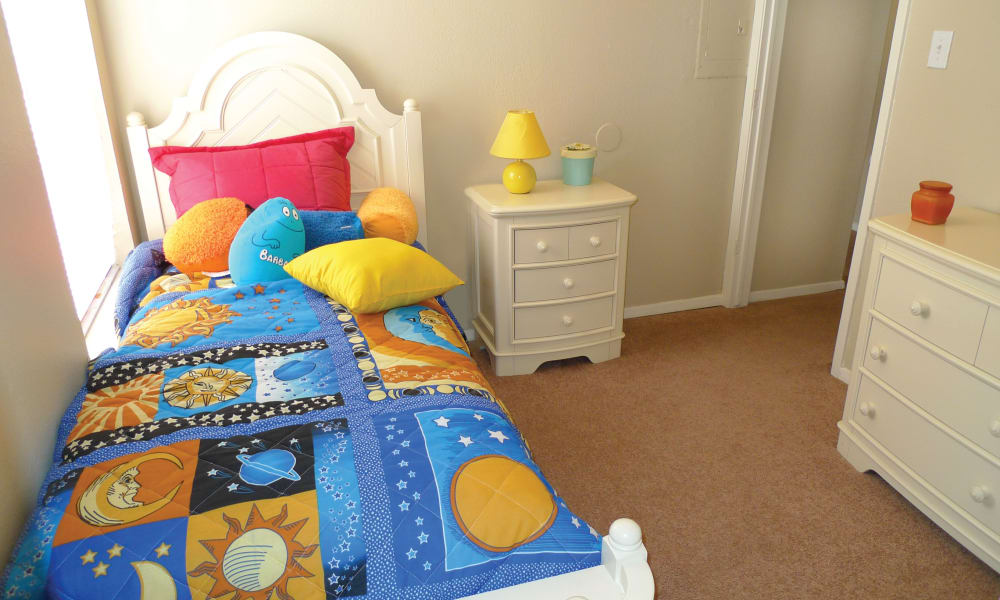 Enjoy a cozy bedroom at Ladera Palms apartments