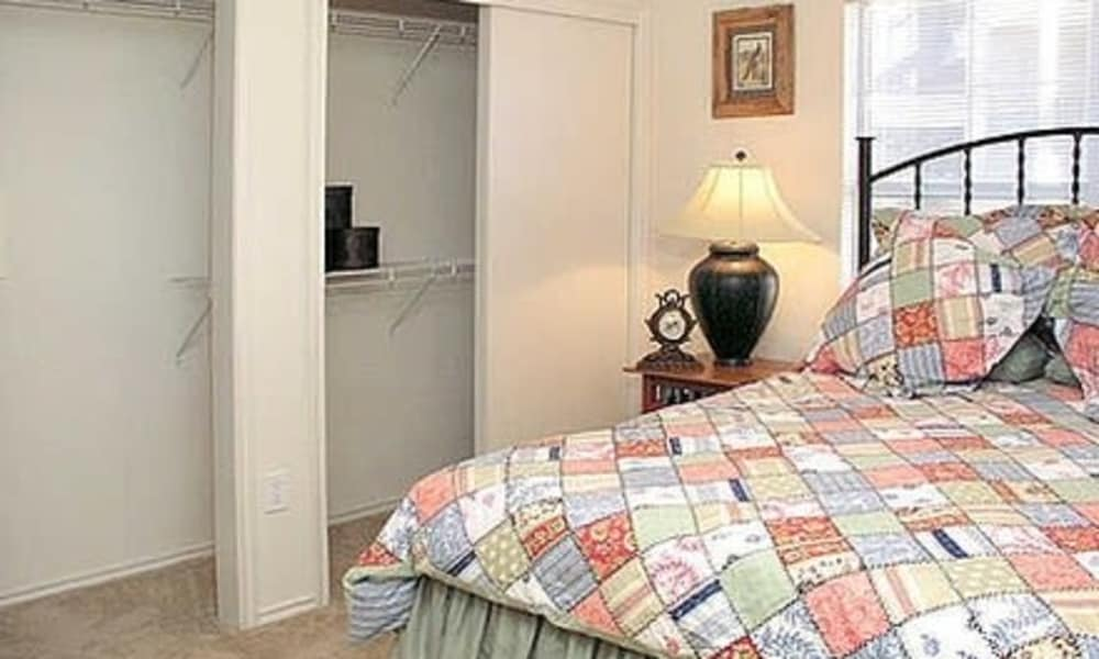 Cozy bedroom at Fort Branch at Truman's Landing apartments