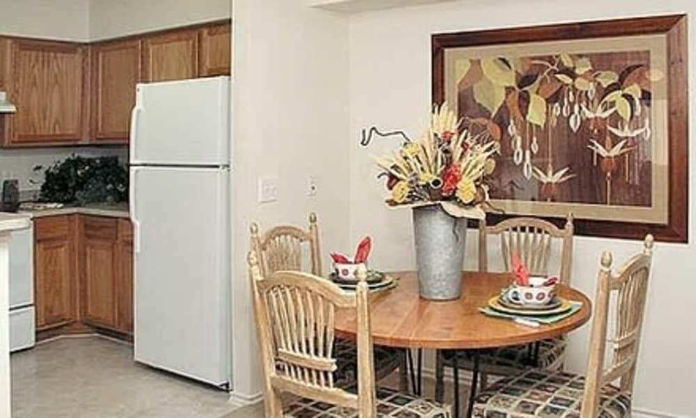 Kitchen and dining area view at Fort Branch at Truman's Landing apartments