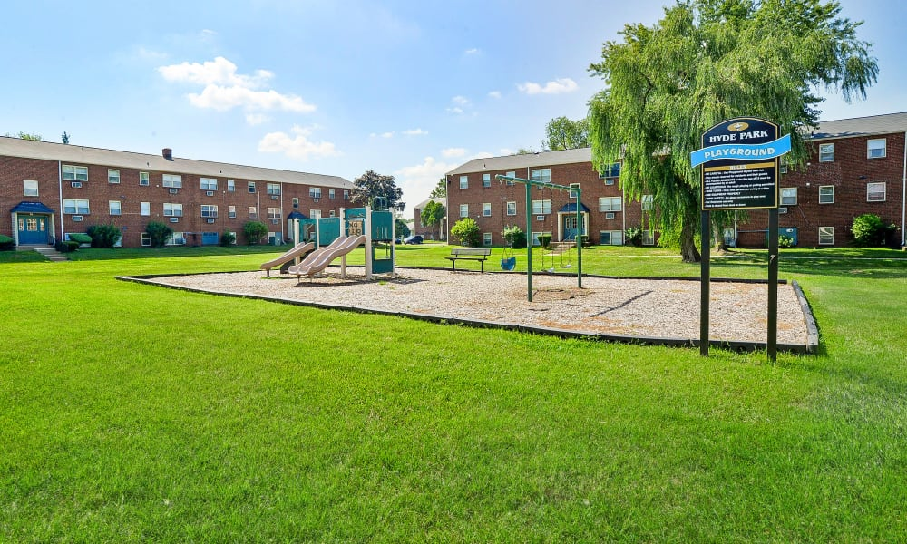 Enjoy apartments with a playground at Hyde Park Apartment Homes