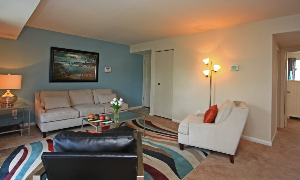 Charlesmont Apartment Homes offers a naturally well-lit living room in Dundalk, Maryland