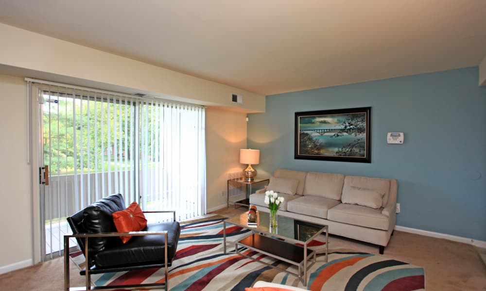 Charlesmont Apartment Homes offers a spacious living room in Dundalk, Maryland