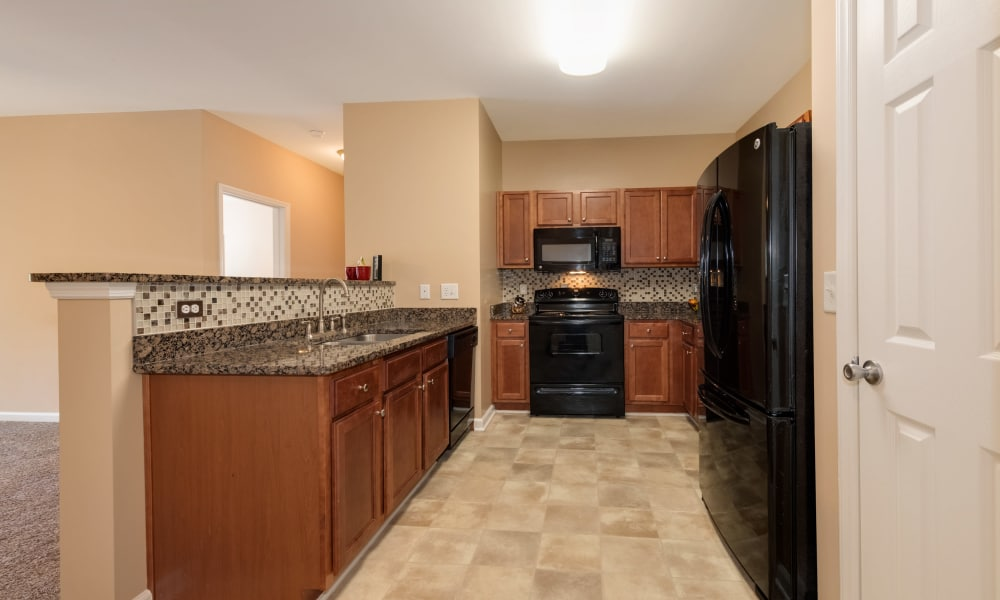 The Waterway Apartment Homes offers a kitchen in Lexington, SC