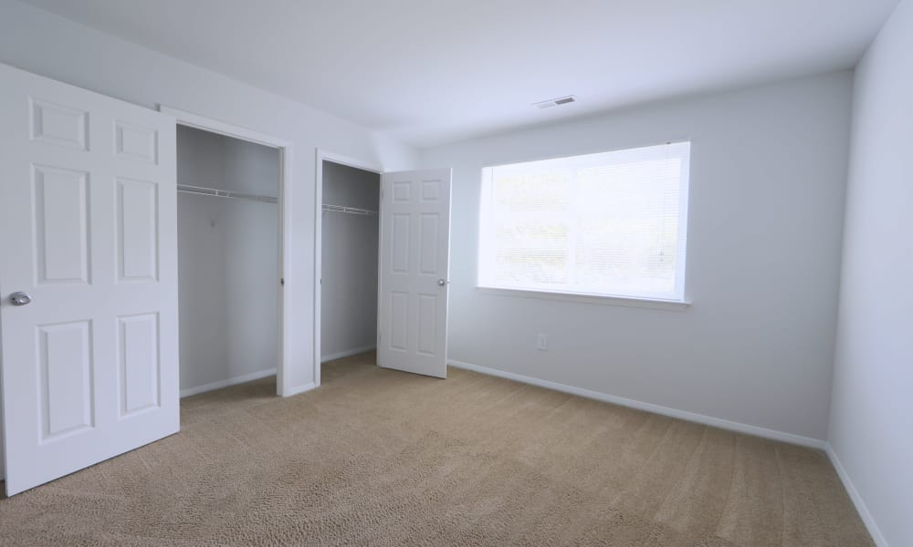 Bedroom with closet at Willowood Apartment Homes in Westminster, MD
