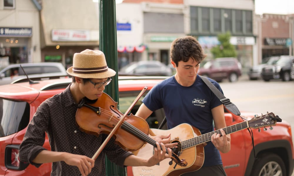 Two musicians playing in the streets of Rochester Hills