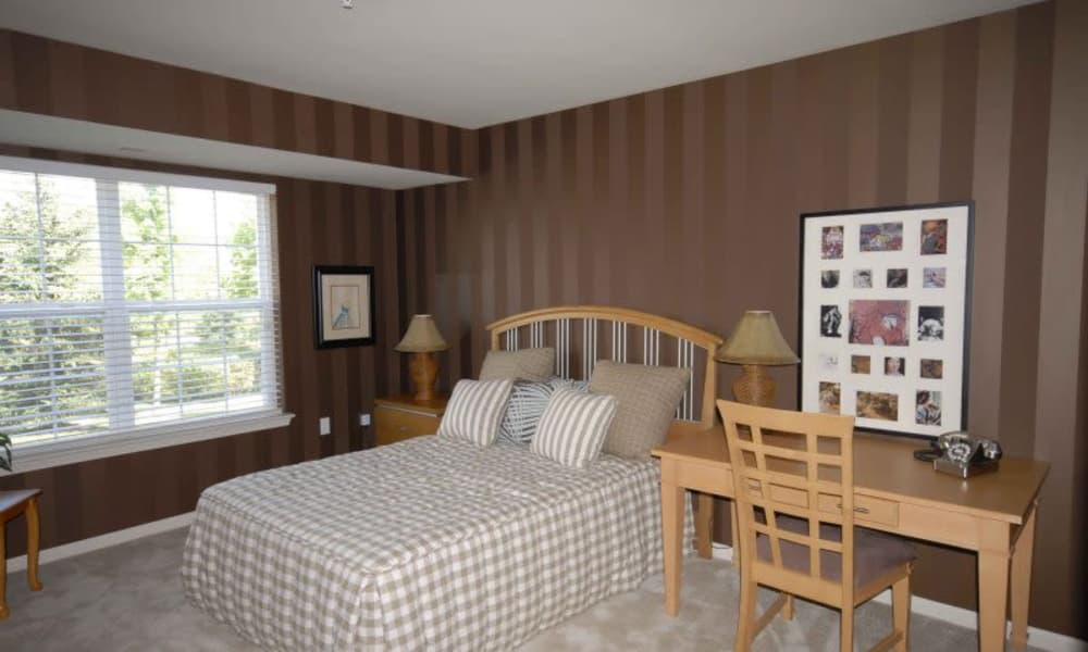 CiderMill Village apartments in Rochester Hills showcase a cozy bedroom