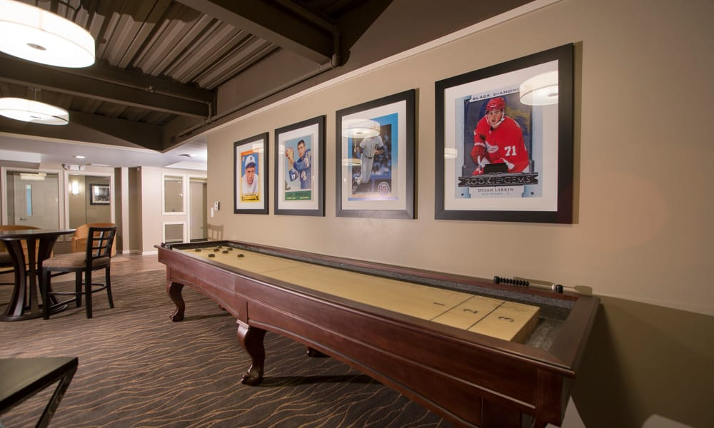 Community clubhouse with a shuffle board at MainCentre