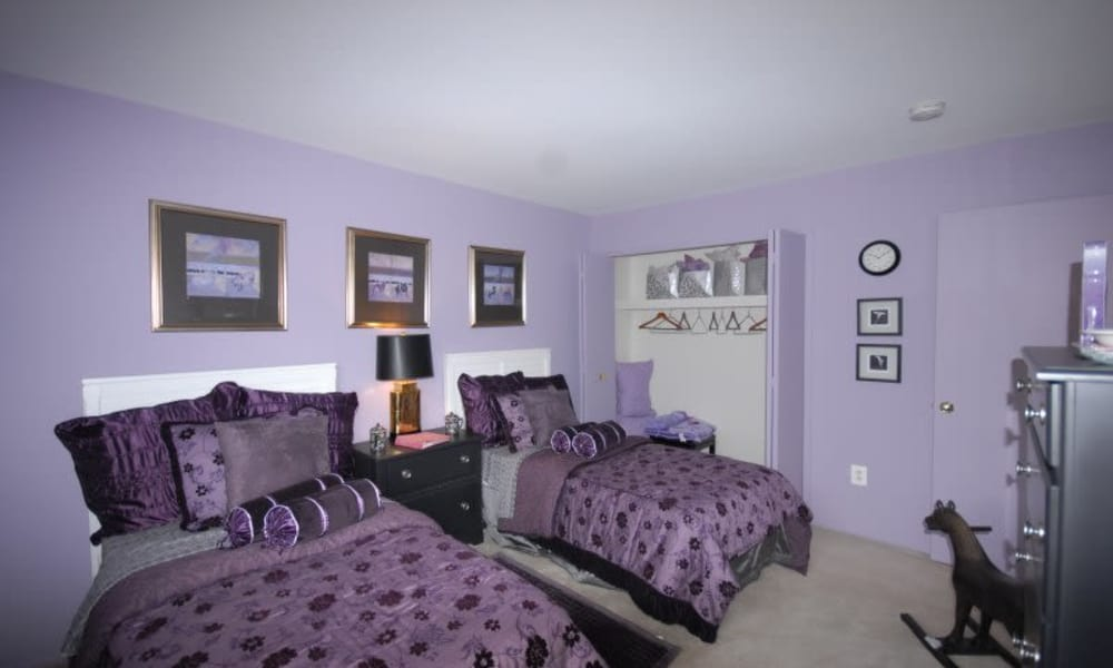 Purple bedroom with twin beds at Northridge