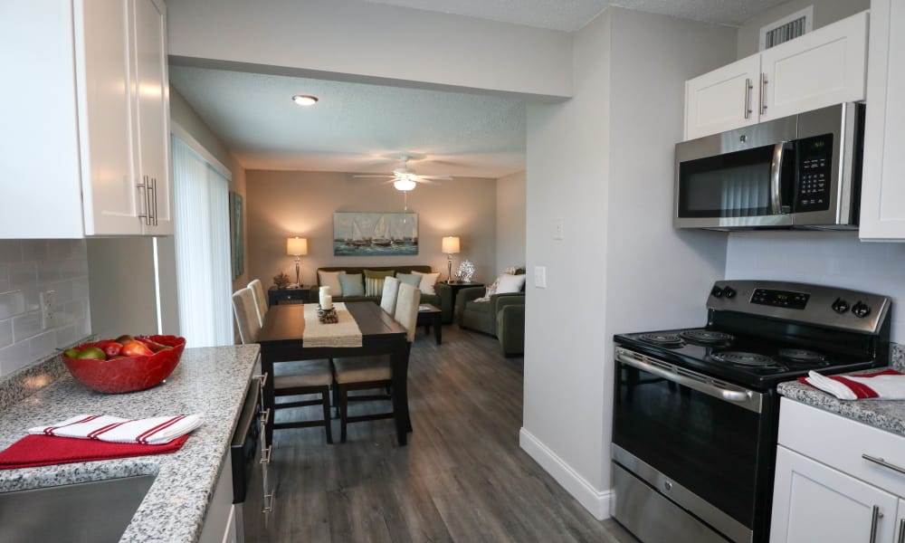 Renovated kitchens include granite counters and stainless appliances at Ridgeview Apartments in Seminole, Florida
