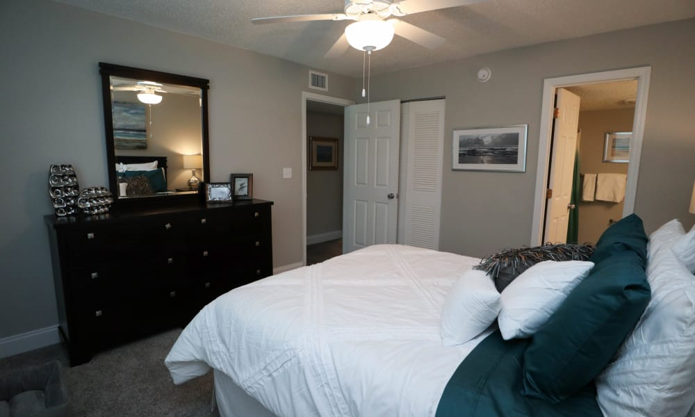 Renovated master bedroom at Ridgeview Apartments in Seminole, Florida