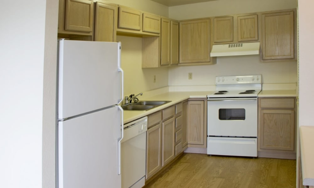 Kitchen with hardwood floors at Mountain View Apartments