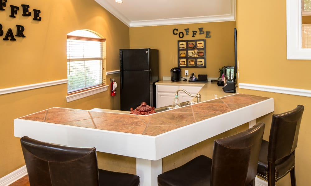 Our apartments in Arlington, TX showcase a beautiful kitchen with breakfast bar
