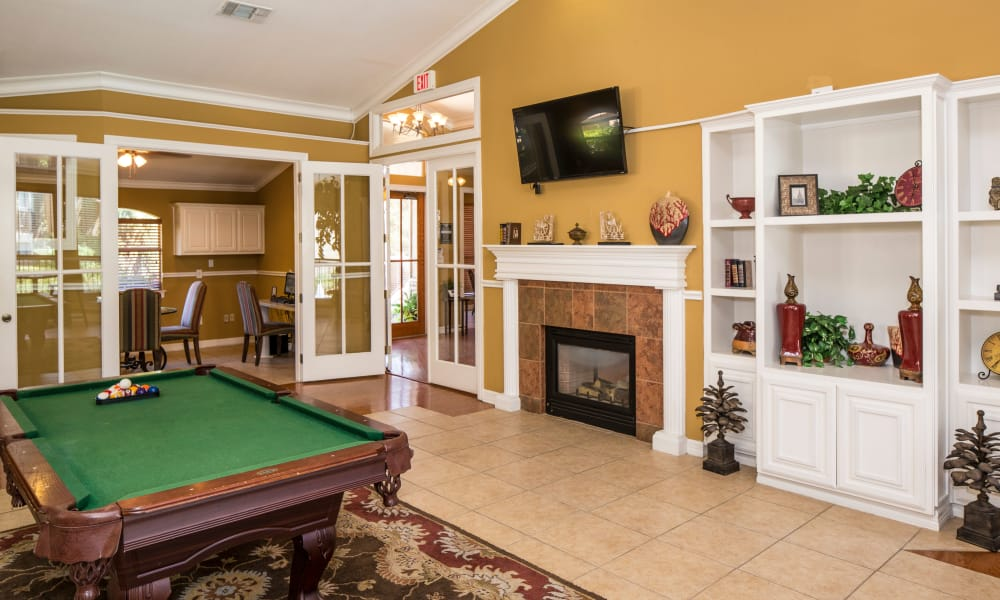 Living room with billiards table at Heritage Fields in Arlington, TX