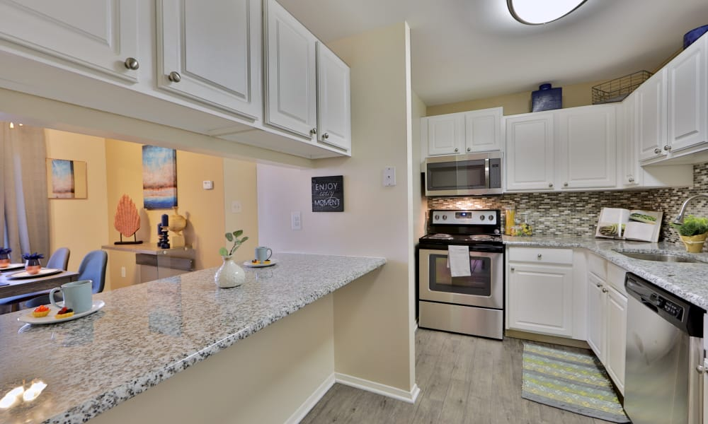 Silver Spring Station Apartment Homes offers a fully equipped kitchen in Baltimore, MD