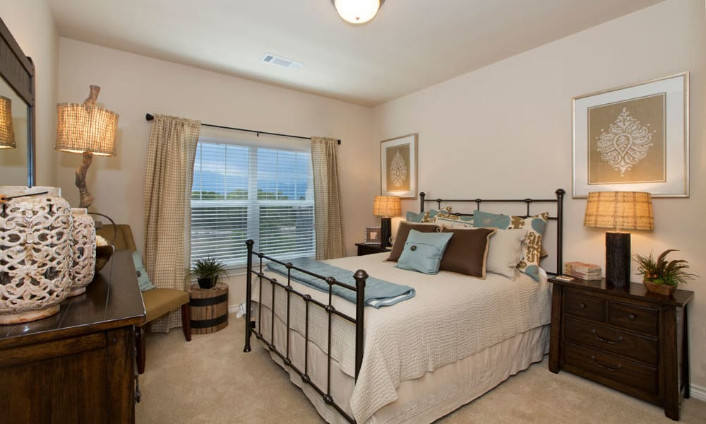 Peaks at Woodmen Apartments showcase a cozy bedroom in Colorado Springs