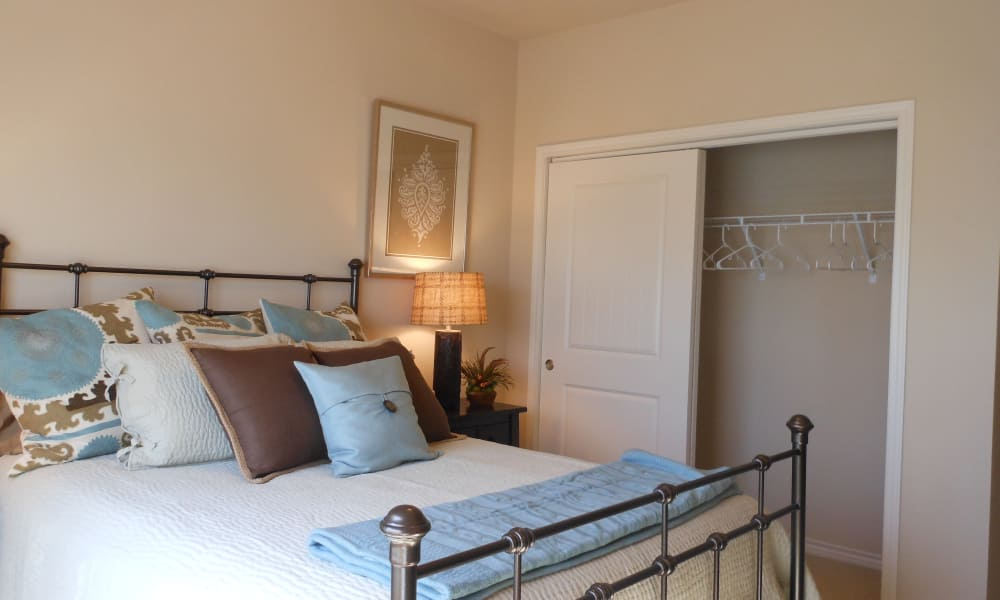 Cozy bed at Peaks at Woodmen Apartments