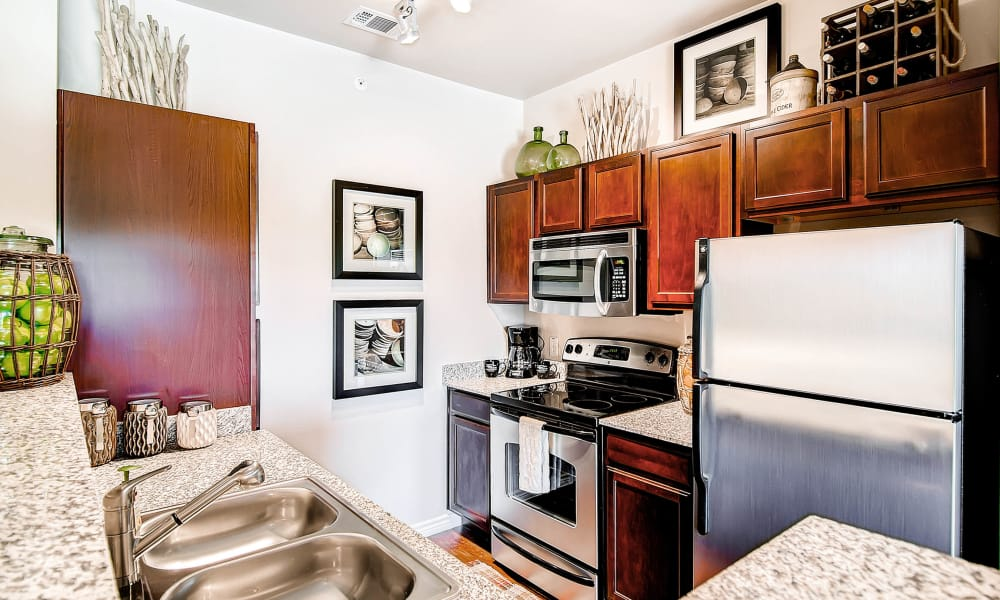 Enjoy a full-equipped kitchen at Peaks at Woodmen Apartments