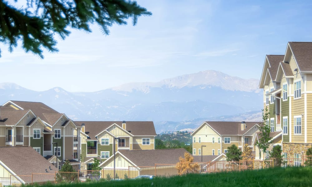 View of the Peaks at Woodmen Apartments community and mountains in Colorado Springs, Colorado