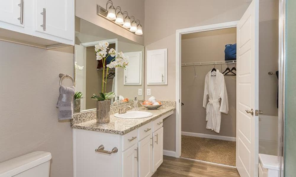 Bathroom and closet at Retreat at Cheyenne Mountain Apartments