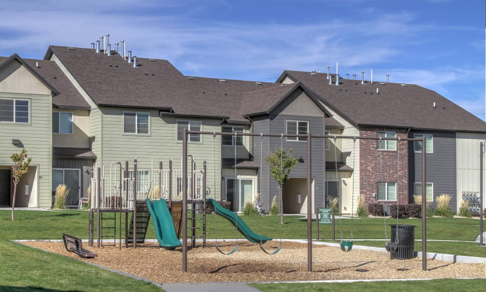 Apartment buildings and playground at Wilshire Place Apartments