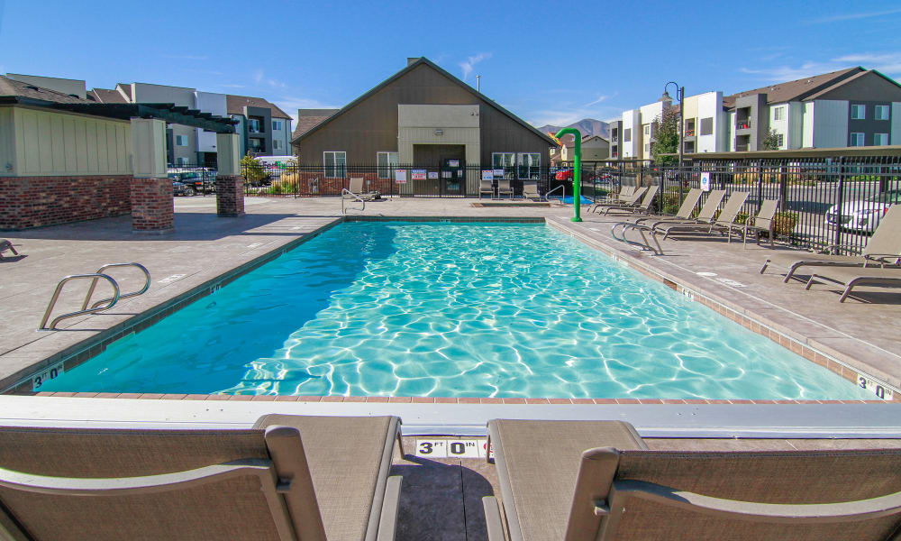 Wilshire Place Apartments offers a sparkling swimming pool in West Jordan