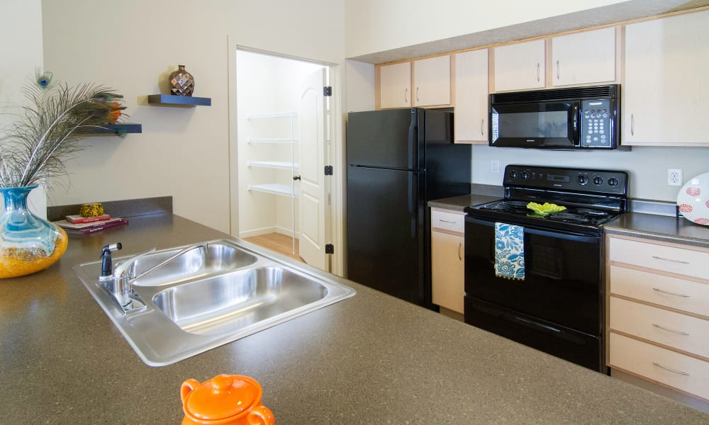 Wilshire Place Apartments showcase a well equipped kitchen in West Jordan