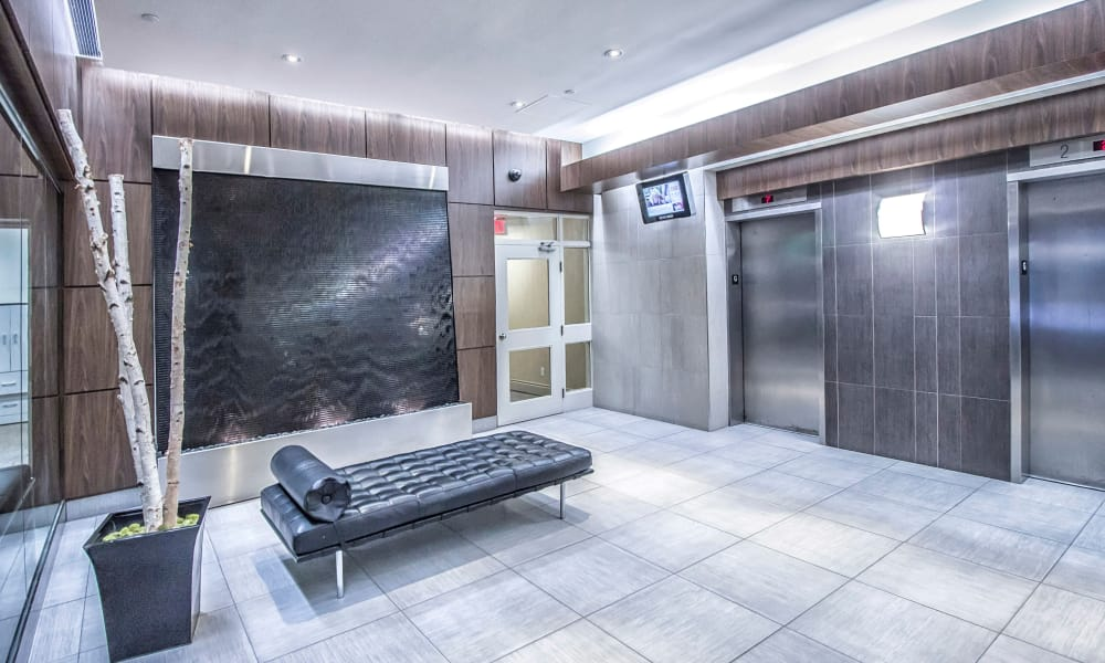 Lobby with elevator at 57 Charles at Bay in Toronto