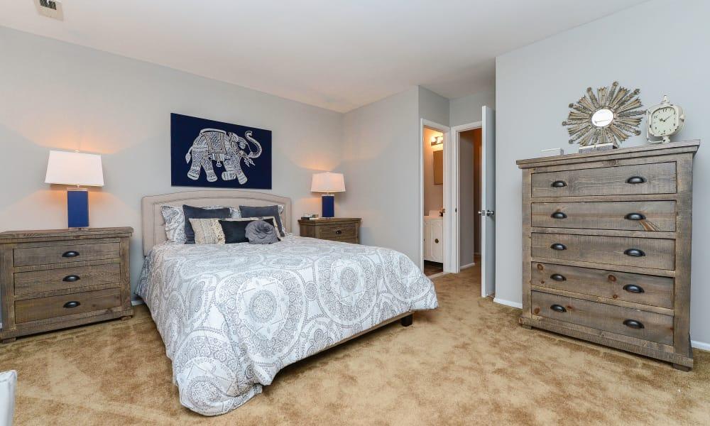 Cozy bedroom at Moorestowne Woods Apartment Homes in Moorestown, New Jersey