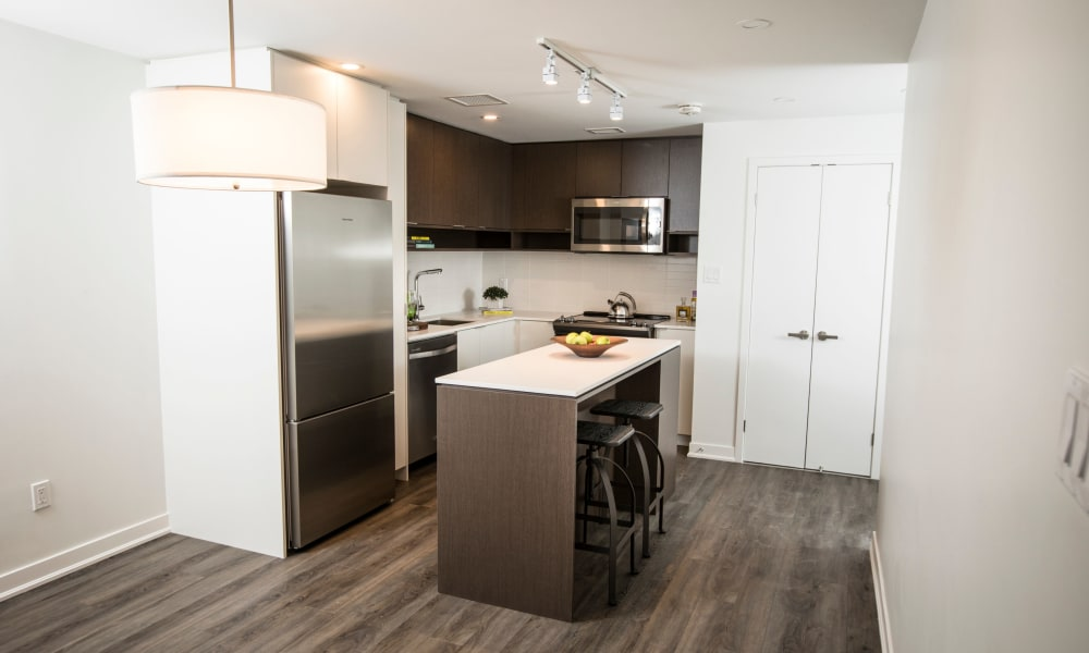 Clean design and stainless steel appliances in a kitchen at Bretton Place in Toronto