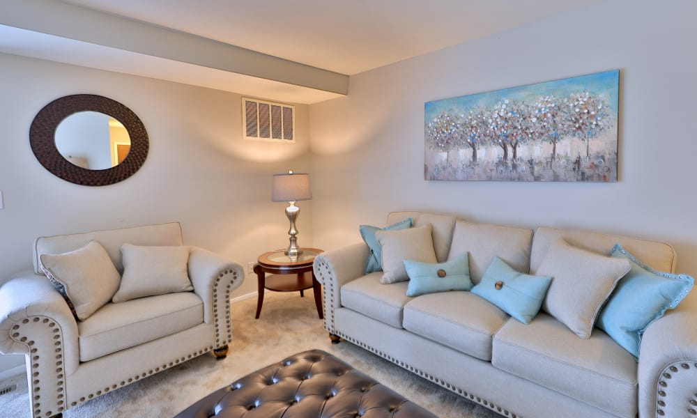 Enjoy a luxury living room at The Village of Chartleytowne Apartments & Townhomes