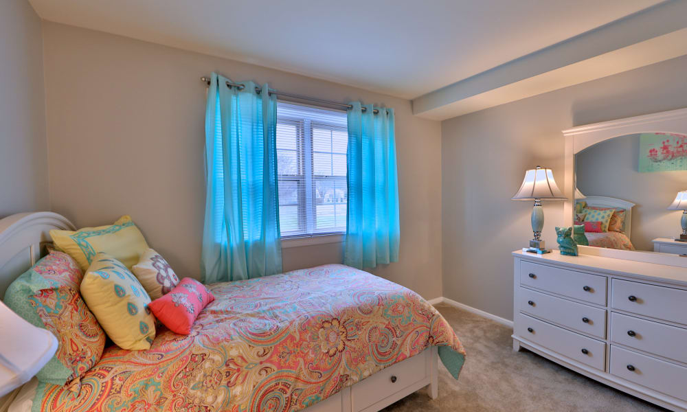 The Village of Chartleytowne Apartment & Townhomes showcase a cozy bedroom