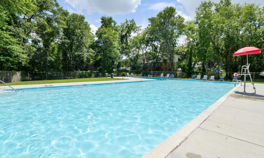 Sparkling pool at The Village of Chartleytowne Apartments & Townhomes