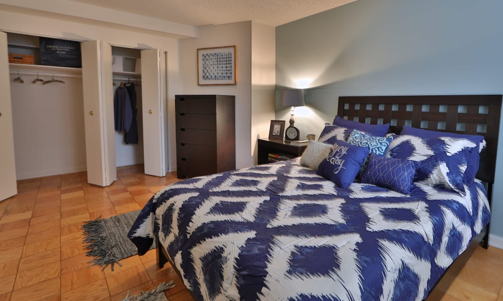 Enjoy a cozy bedroom at The Carlyle Apartments