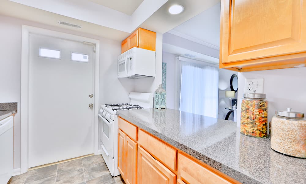 Northwest Crossing Apartment Homes offers a kitchen in Randallstown, Maryland