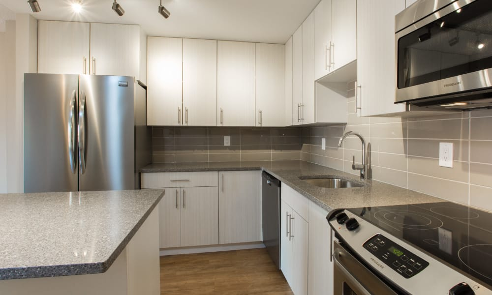Royal View Apartments offers a fully equipped kitchen in Calgary, Alberta
