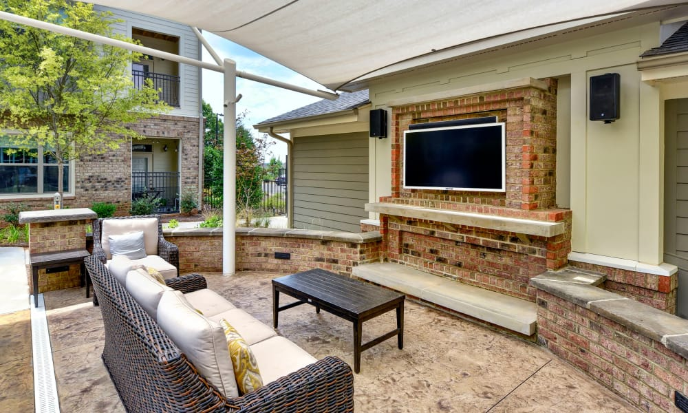 Outdoors living area with TV at Axis Berewick in Charlotte, North Carolina