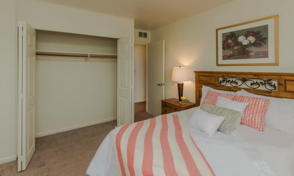 Comfy bed and closet at Rochester Highlands